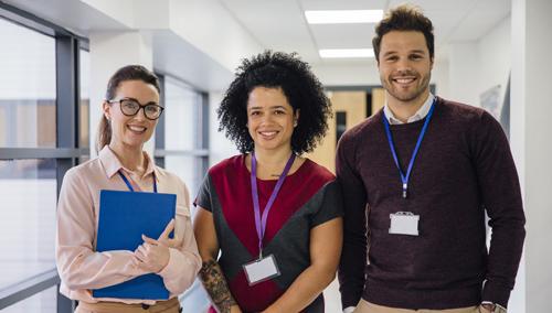 three happy and healthy school teachers enjoying their day at work